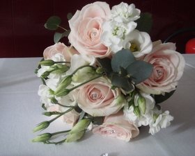 Bridesmaids bouquet of Sweet avalanche roses, stocks, and white lizzianthus