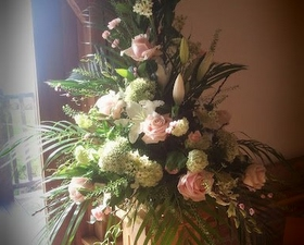 Pedestal arrangement of pink and white flowers
