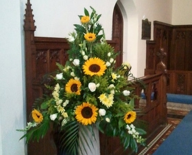 Church pedestal arrangement of sunflowers