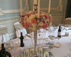Masses candleabra design with roses, hygreangea and pearl draping